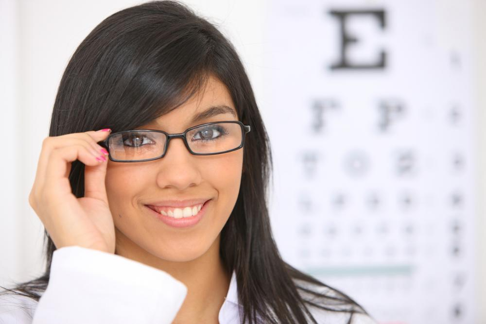 woman standing in front of an eye exam chart in Austin