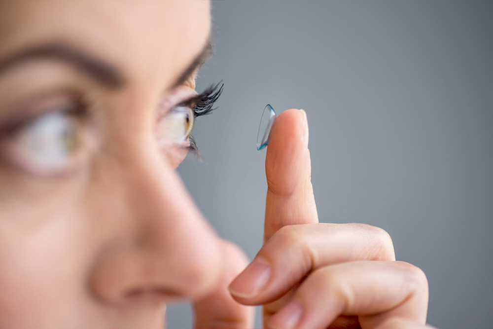 woman putting in her contact lens
